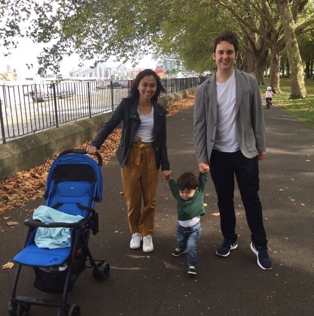 Chris Sharp with his wife and young son, walking along the Embankment in London