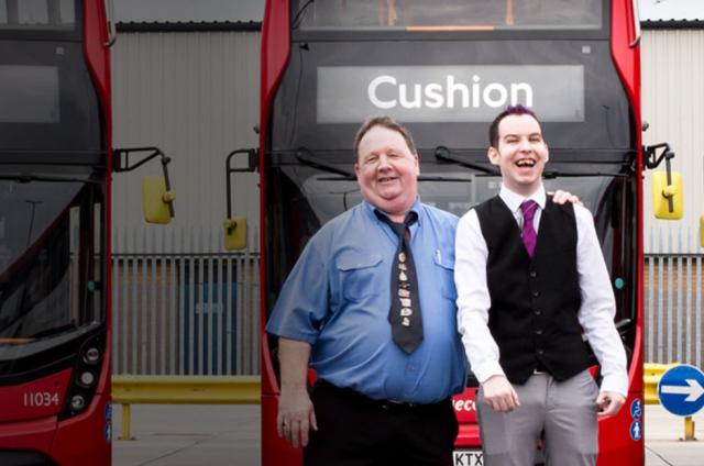 Sean and his dad next to some double decker buses for our Calm, Cushion, Call campaign