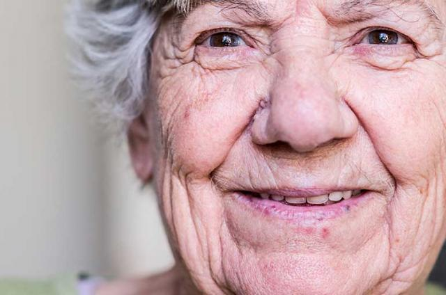 One older person looking at the camera